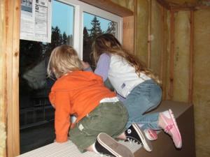 Gigi and Jude peeking out of Gigi's bedroom window.